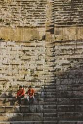 Two boys sit in the seats of the Roman-era amphitheater at Jerash, Jordan