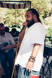 A local MC provides musical accompaniment